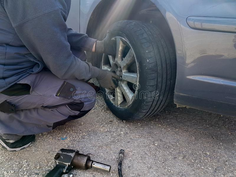Car flat tire change replace on the road problem emergency stock image