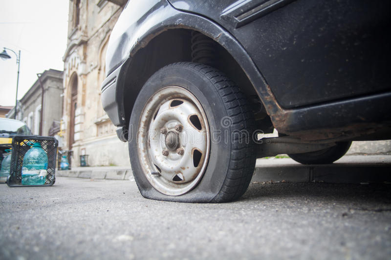 Car flat tire. Close up shot of a car with a flat tire stock images