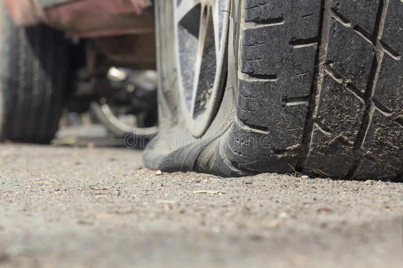 Car flat tire. On road stock images