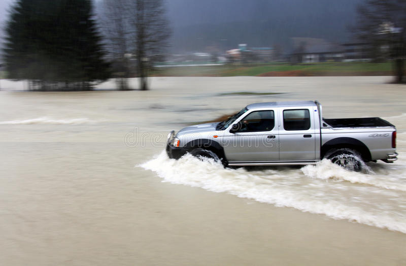 Car on flooded road stock photography