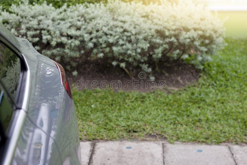 Beside of car focus on lamp. Of car with nature of grass and tree on outdoor royalty free stock photography