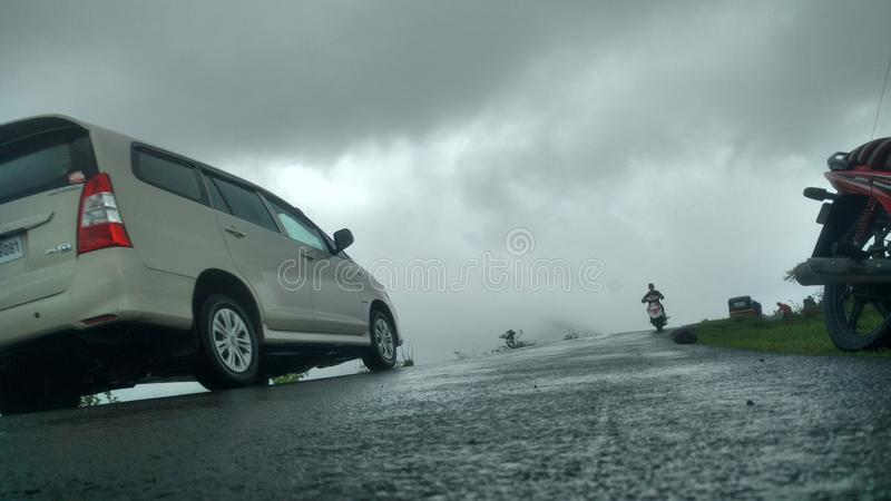 Car in foggy weather and beautiful roads royalty free stock photos