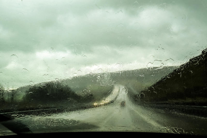 Car front window view during rain stock photography