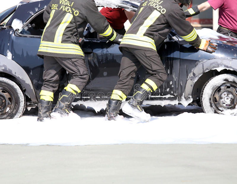 Car full of foam after switching off of the fire. On board royalty free stock photography