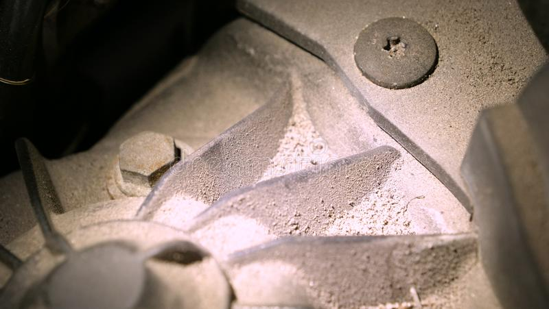 In a car garage under the hood is a very dirty car engine preparation for a full chemical cleaning. Concept of: Full number, Very. Dirty, Not safe, Car parts stock photos