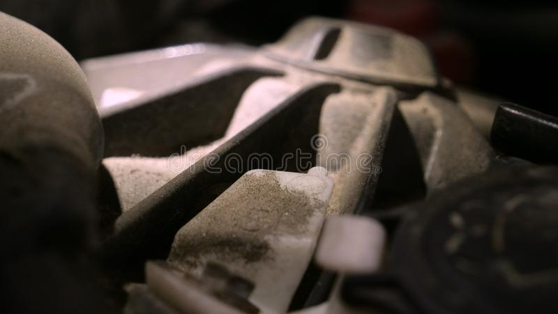 In a car garage under the hood is a very dirty car engine preparation for a full chemical cleaning. Concept of: Full number, Very. Dirty, Not safe, Car parts royalty free stock image