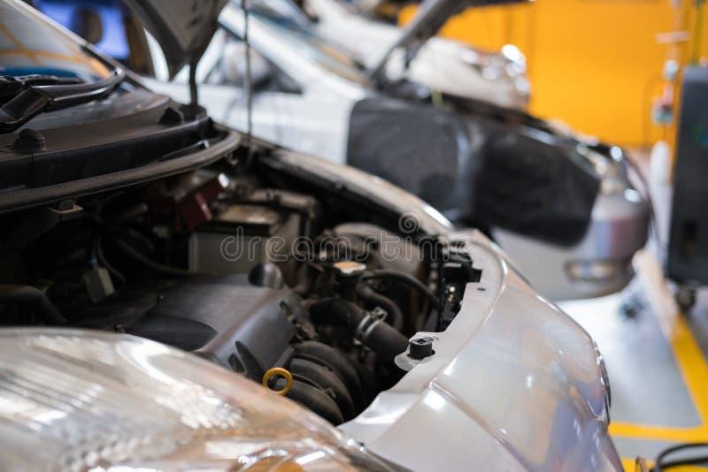 Car in garage. vehicle maintenance in auto repair service. automobile annual checkup. fixing, checking concept. Car in garage. vehicle maintenance in auto repair stock photos