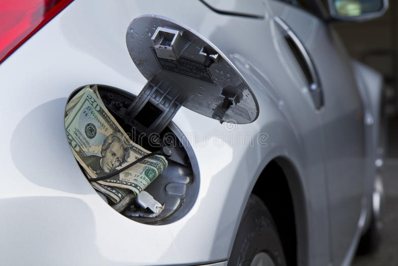 car, gas cap and money stock photos