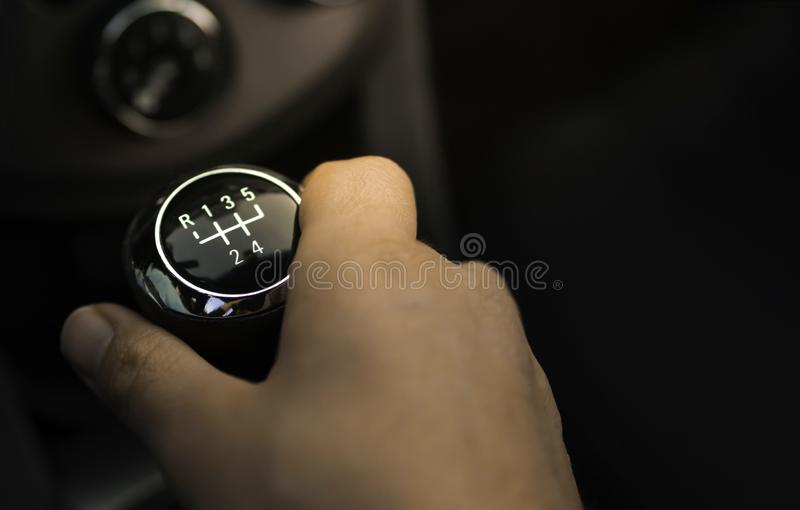 Car with gear lever and hand standing on it. gear shifter person.  stock photos
