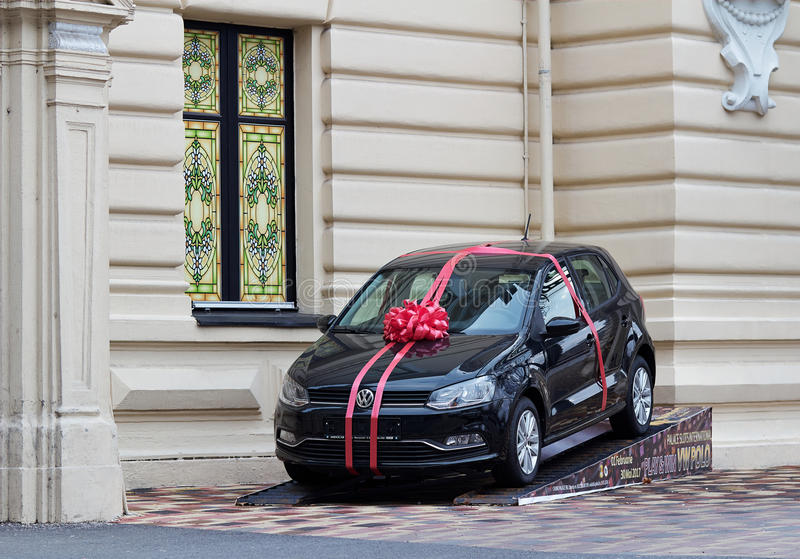 Car gift Volkswagen Polo. Volkswagen Polo with a bow-knot on a ramp royalty free stock images