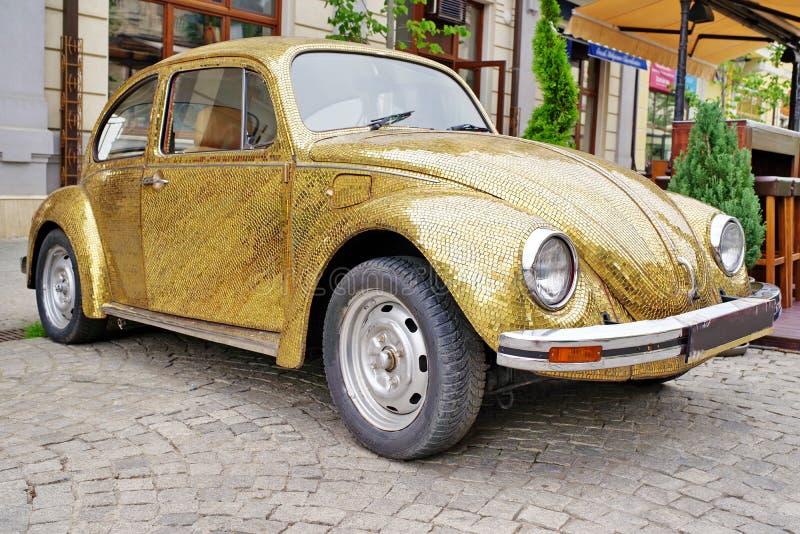 Luxury gilded car - Volkswagen Beetle royalty free stock photo