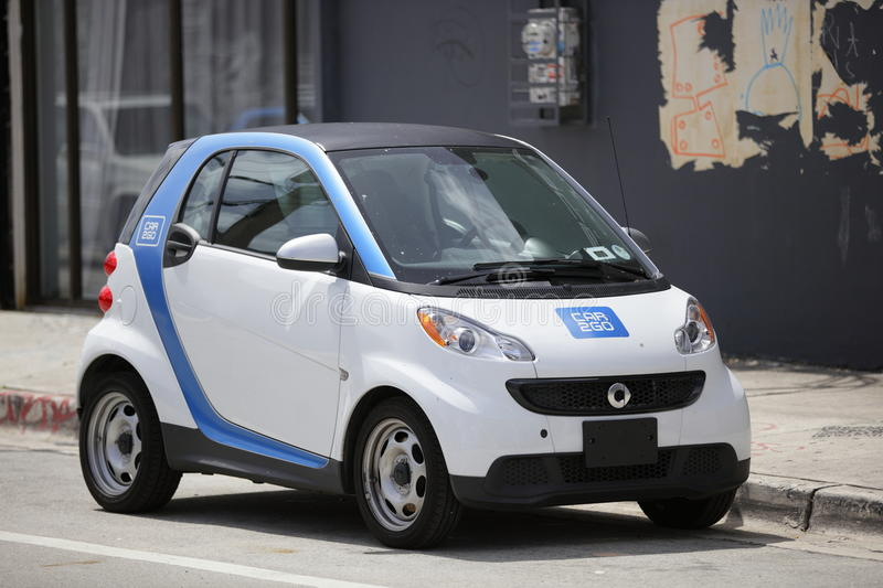 Car 2 Go Miami. MIAMI - JUNE 15, 2015: Image of a two seater smartcar parked on the streets of Miami. Car2go is a community car rental company which places cars stock photography