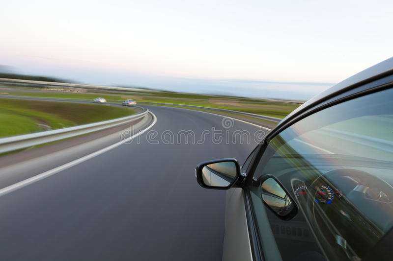 Car goes very fast to turn. A country road at night stock image