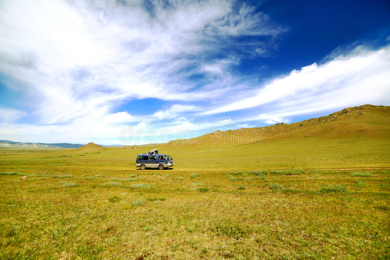 Car going beautiful mongolian offroad. Mini Van going at beautiful offroad at mongolian steppe stock image
