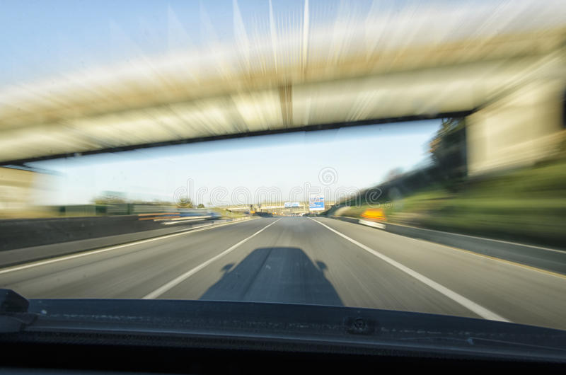 Car going too fast. On the highway stock image