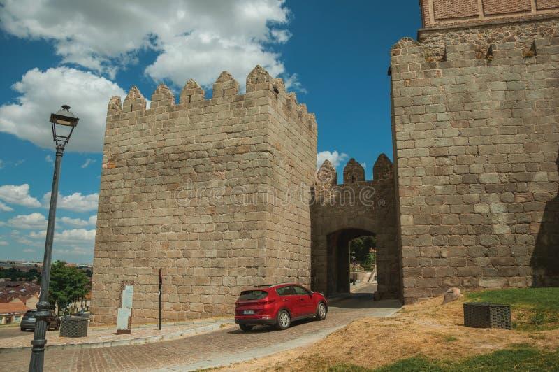 Car going toward Carmen Gateway in the city wall of Avila royalty free stock image