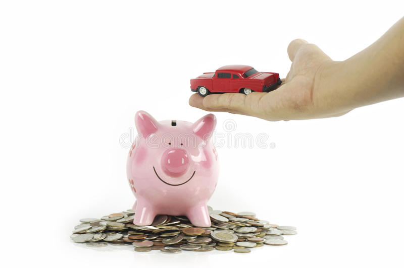 Car in hand with pink piggy bank. On coins isolated stock photos