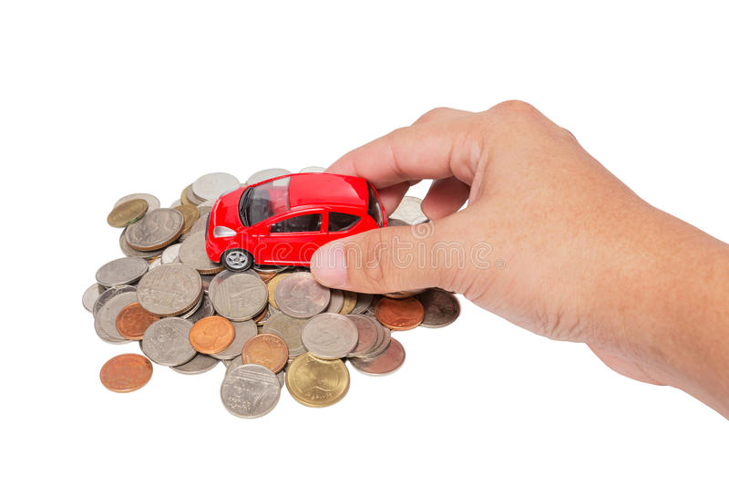 Car with hand stand on a pile of coins. Isolated on white background stock photo