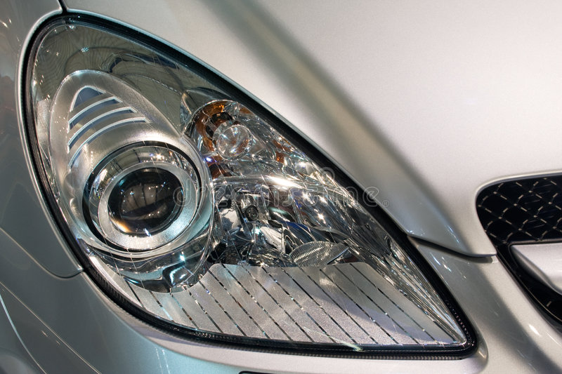 Car head lamp. Close-up of a new modern car head lamp royalty free stock photography