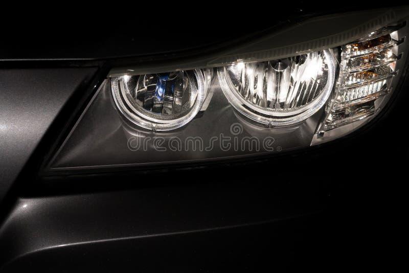 Car headlamp reflections royalty free stock photo