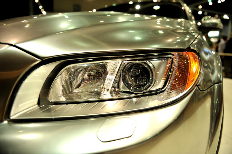 Car headlight. Detail of a trendy headlight from a modern car of european design royalty free stock image