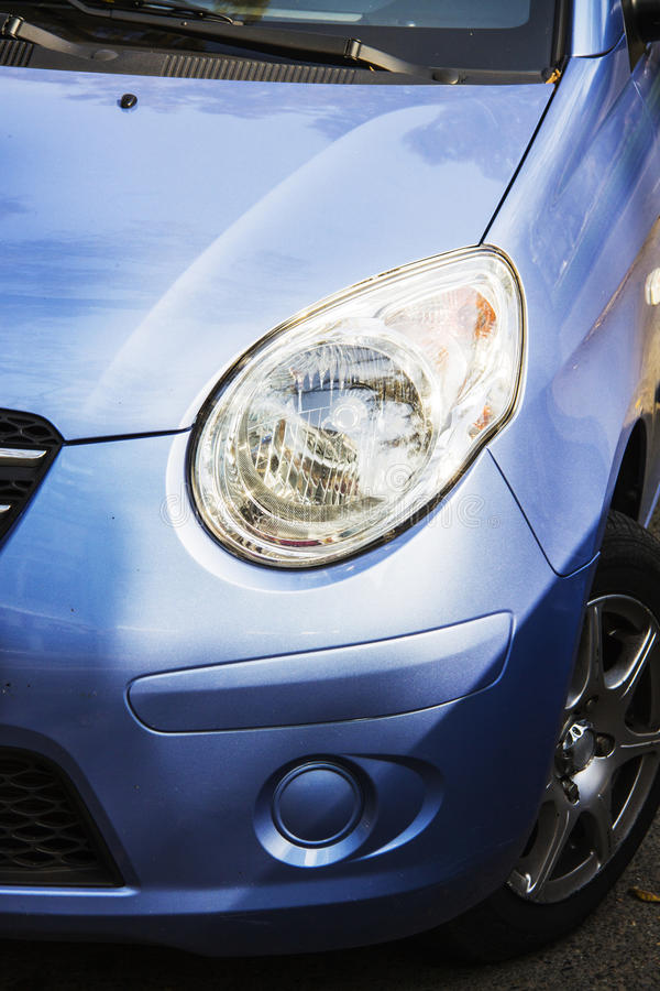 Car headlight. Detail of headlamp and part of grill on front end of car stock images