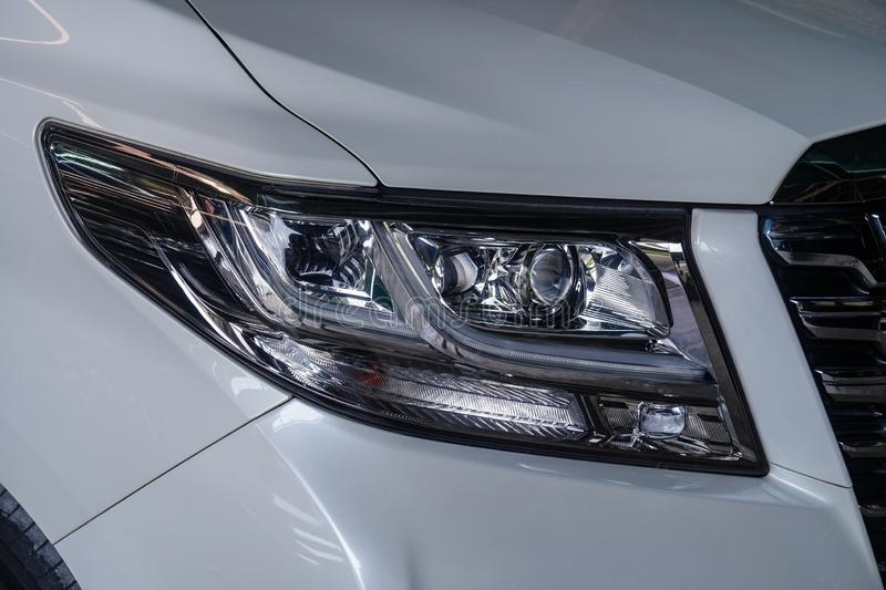 Car headlight with shallow depth of field closeup royalty free stock photography