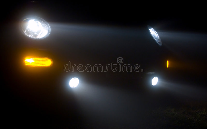 Car headlights stock photography