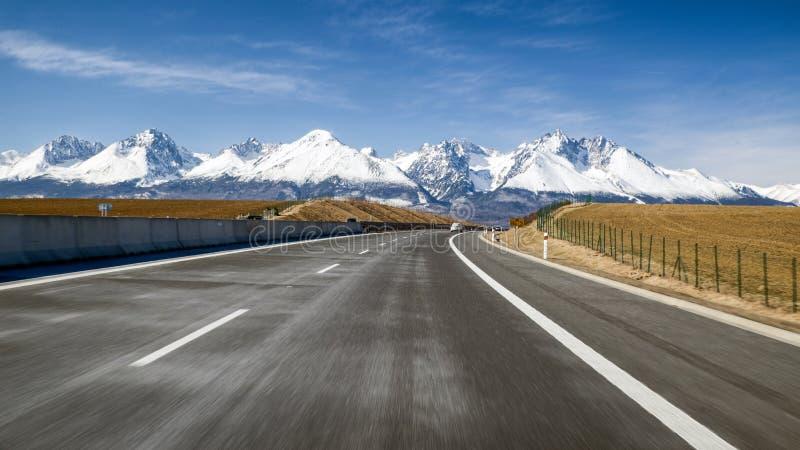 Car on highway and Tatra mountains, Slovakia stock photography