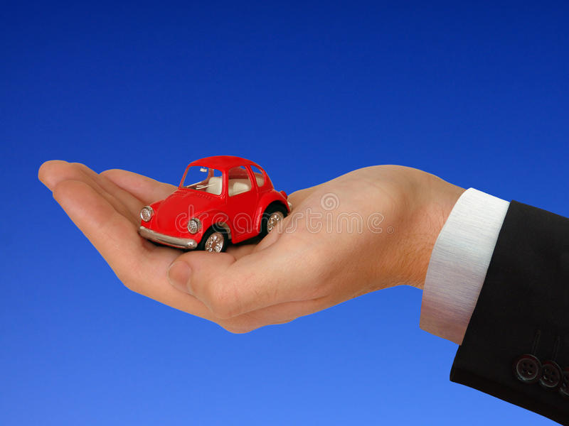 The Car in the Human hand royalty free stock photos