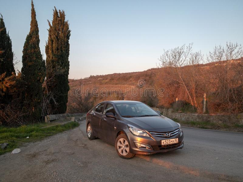 The car Hyundai Solaris is parked in nature. Giad Accent / Hyundai Avega / Hyundai Brio / Dodge Verna. Sevastopol, Republic of Crimea - March 23, 2019: The car royalty free stock image