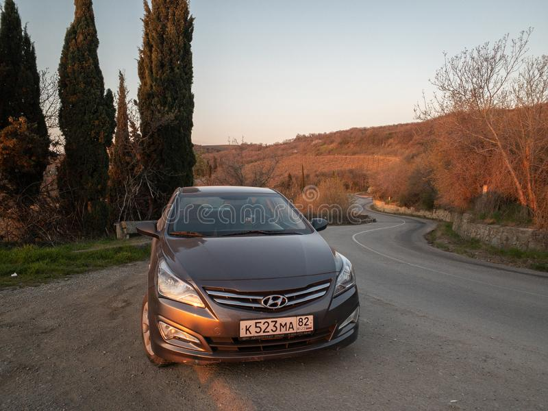 The car Hyundai Solaris is parked in nature. Giad Accent / Hyundai Avega / Hyundai Brio / Dodge Verna. Sevastopol, Republic of Crimea - March 23, 2019: The car royalty free stock images
