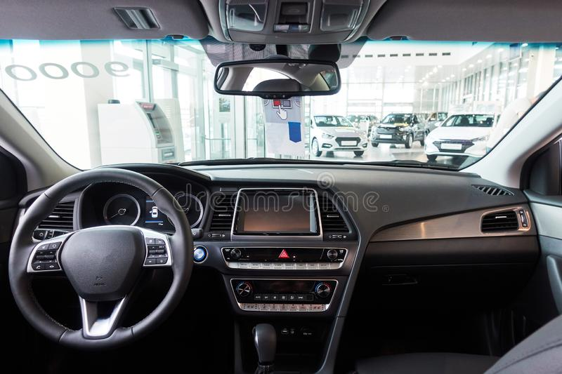 The car inside the driver`s seat. The interior of a prestigious modern car. New car inside stock image