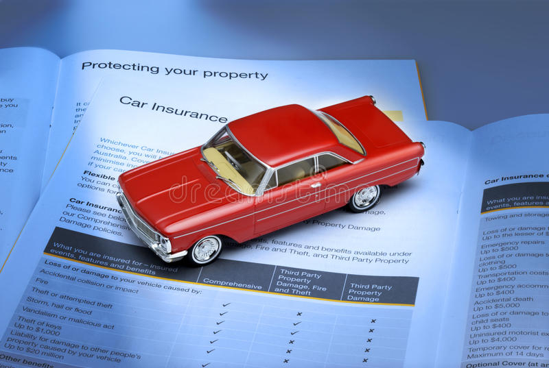 Car Insurance. An open brochure for car insurance with a toy car royalty free stock images