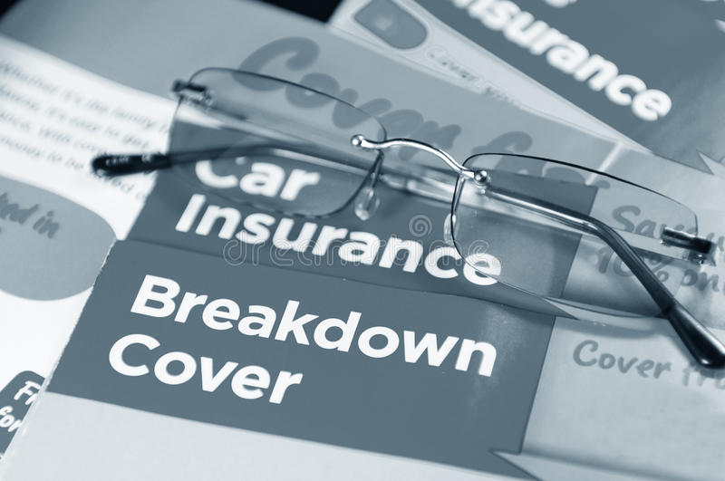 Car insurance. And breakdown cover leaflets and glasses stock photos