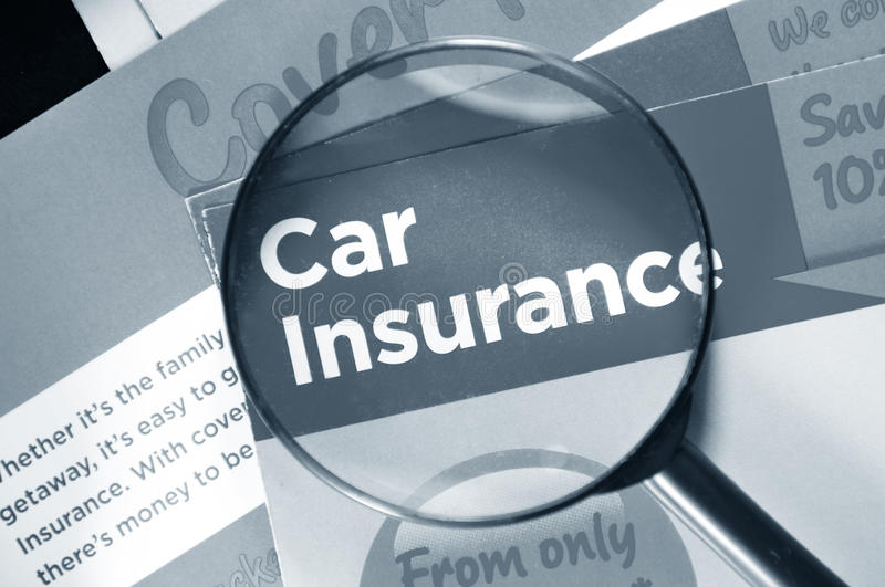 Car insurance. And breakdown cover leaflets and glasses royalty free stock photos