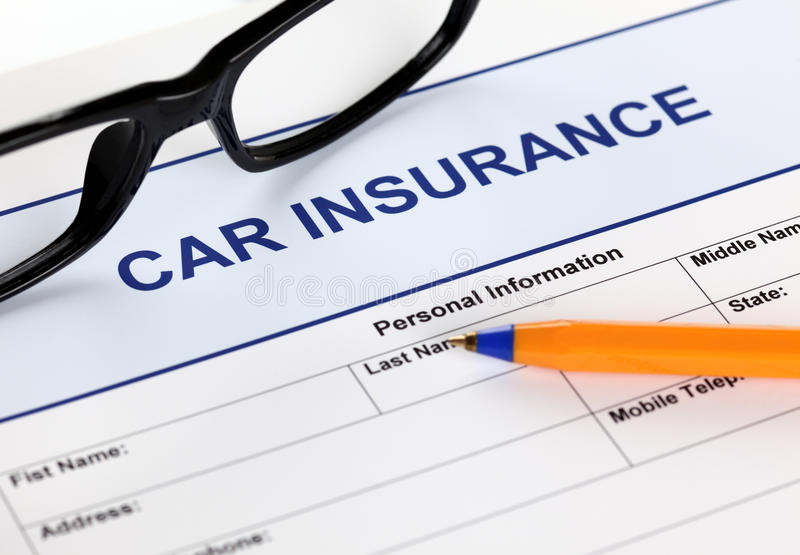 Car insurance. Application form with glasses and ballpoint pen stock photo