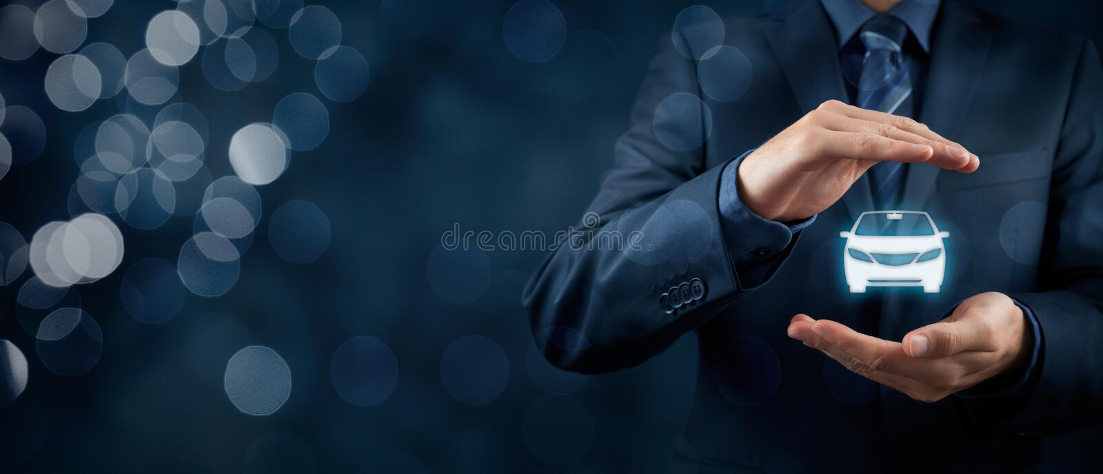 Car insurance. Car (automobile) insurance and collision damage waiver concepts. Businessman with protective gesture and icon of car. Wide banner composition and royalty free stock photos