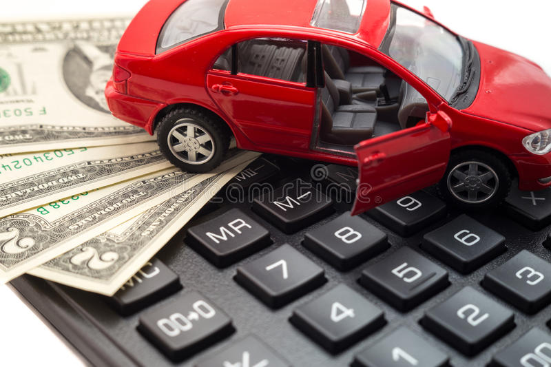 Car insurance. Car on a calculator and money for insurance royalty free stock images
