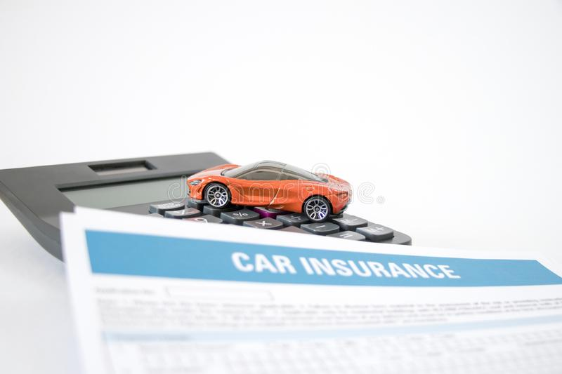 Car insurance concept with car insurance form, toy car and calculator stock images