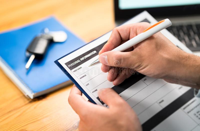 Car insurance form, bank loan or lease agreement. Car insurance form, bank loan, lease agreement or repair contract. Man writing personal information to document stock photos
