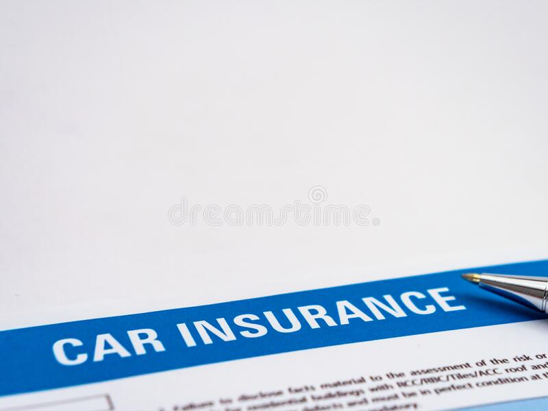 Car Insurance Paper With A Ball Pen Nib In The Side Stock ...