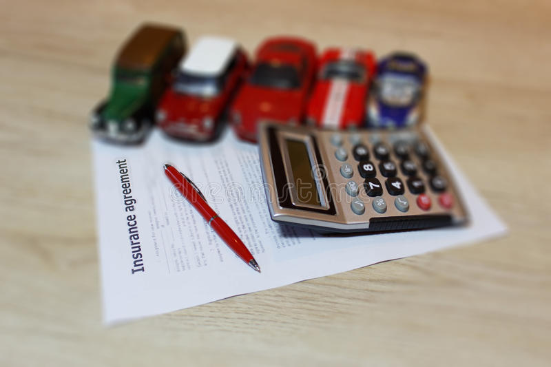 Car insurance policy. Auto insurance claim form with fountain pen and calculator. Car insurance policy. Insurance concept. Auto insurance claim form with royalty free stock photo
