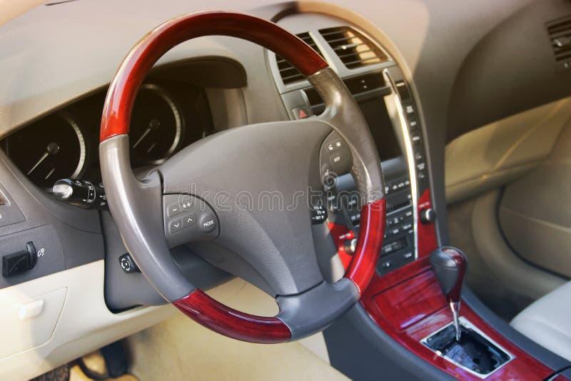 Car interior. Car dashboard, illuminated panel, speed display royalty free stock image