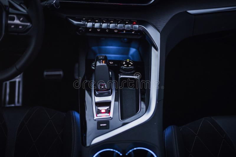 Car Interior: Center Console with dials, buttons and gear knob royalty free stock photo