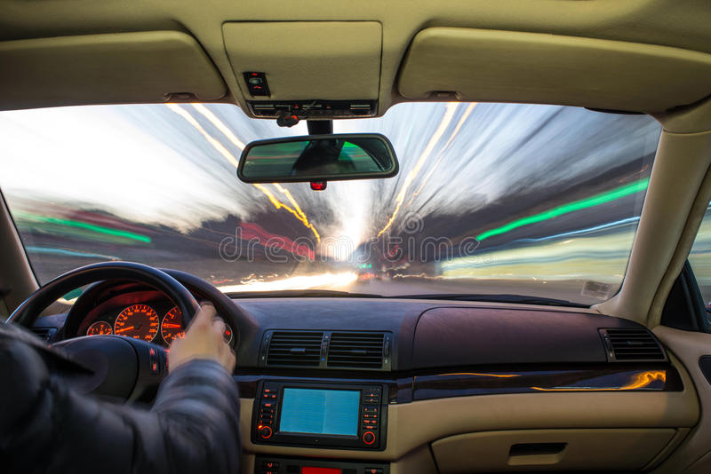 Car interior on driving. Blurred night lights stock photography