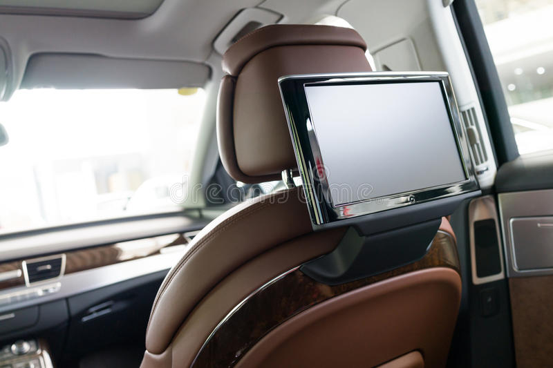 Car interior. Entertainment system,LCD screen hanging on the back of the seat royalty free stock photography