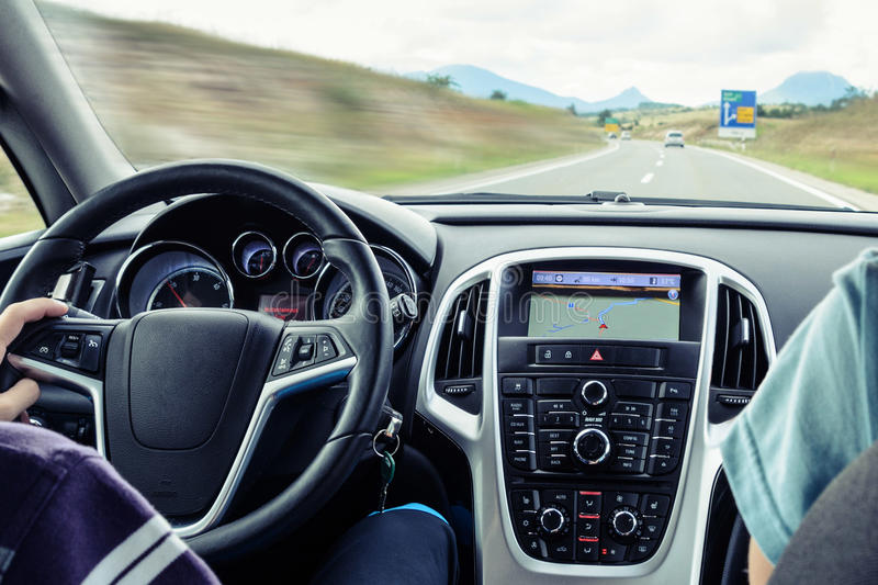 Car interior fast driving. With navigation on the highway stock photography