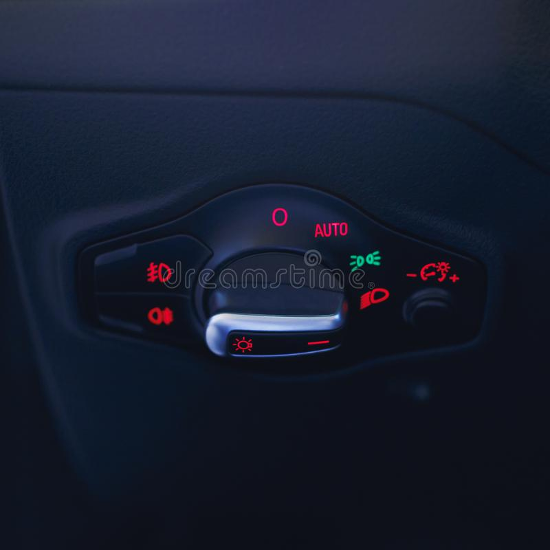 Car interior with light switch.the light knob in the car. Multifunction Headlight Console Control Switch Knob stock photo