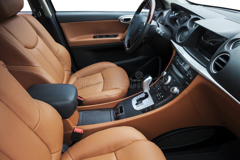 Car interior. The luxury car cab interior , yellow soft leather seats, shift lever,center stack, steering wheel royalty free stock photography